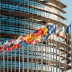 depositphotos_43781563-stock-photo-european-parliament-frontal-flags