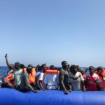 """Taken from a """"rhib"""", an inflatable dinghy, belonging to the 'Ocean Viking' rescue ship, operated by French NGOs SOS Mediterranee and Medecins sans Frontieres (MSF), some 81 migrants are rescued during an operation in the Mediterranean Sea on August 11, 2019. - The rescue operation comes as a dispute escalates over which countries will take in migrants rescued by different charity ships operating in the area, as mild Mediterranean weather increases the number of people trying to make their way to Europe from Africa. (Photo by Anne CHAON / AFP)"""