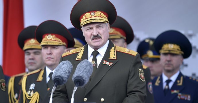 Belarusian President Alexander Lukashenko, center, gives a speech during a military parade that marked the 75th anniversary of the allied victory over Nazi Germany, in Minsk, Belarus, Saturday, May 9, 2020. (Sergei Gapon/Pool Photo via AP)