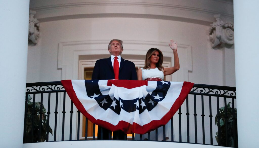 U.S. President Donald Trump and first lady Melania Trump watch the Washington, D.C. fireworks display from the Truman Balcony as they celebrate the U.S. Independence Day holiday at the White House in Washington, U.S., July 4, 2020. REUTERS/Carlos Barria