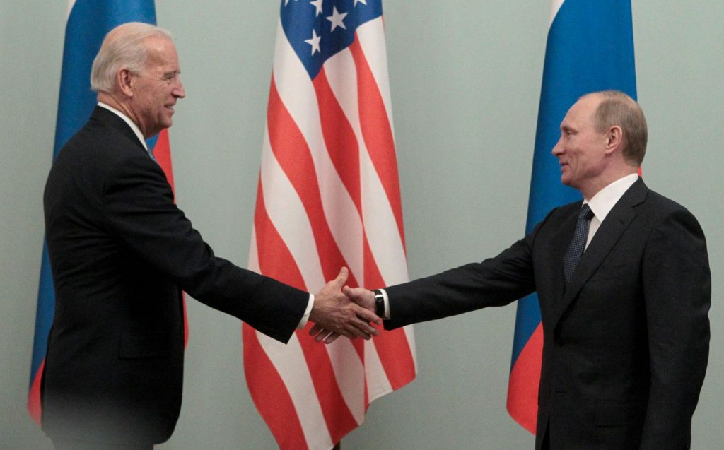 FILE PHOTO: Russian Prime Minister Vladimir Putin shakes hands with U.S. Vice President Joe Biden during their meeting in Moscow March 10, 2011. REUTERS/Alexander Natruskin/File Photo